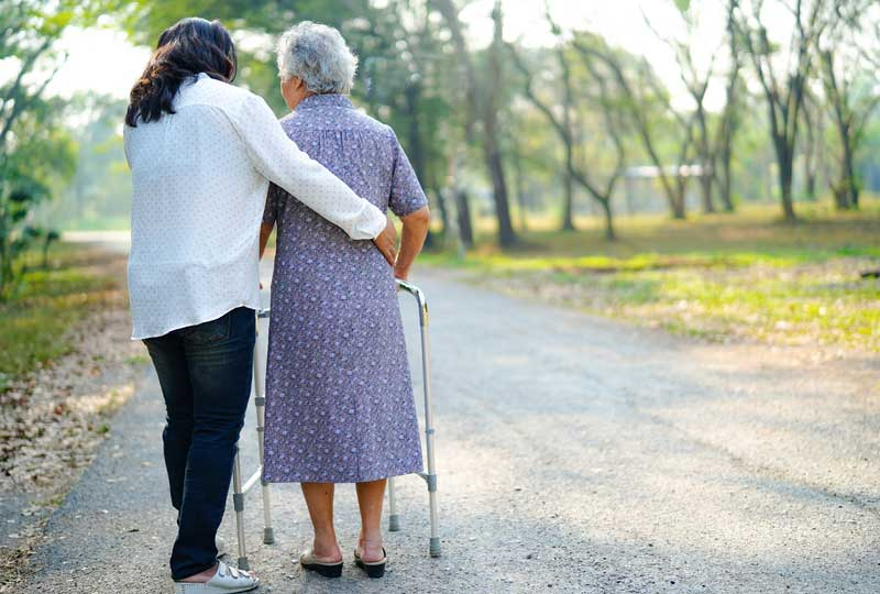 Carer Helping Old Woman