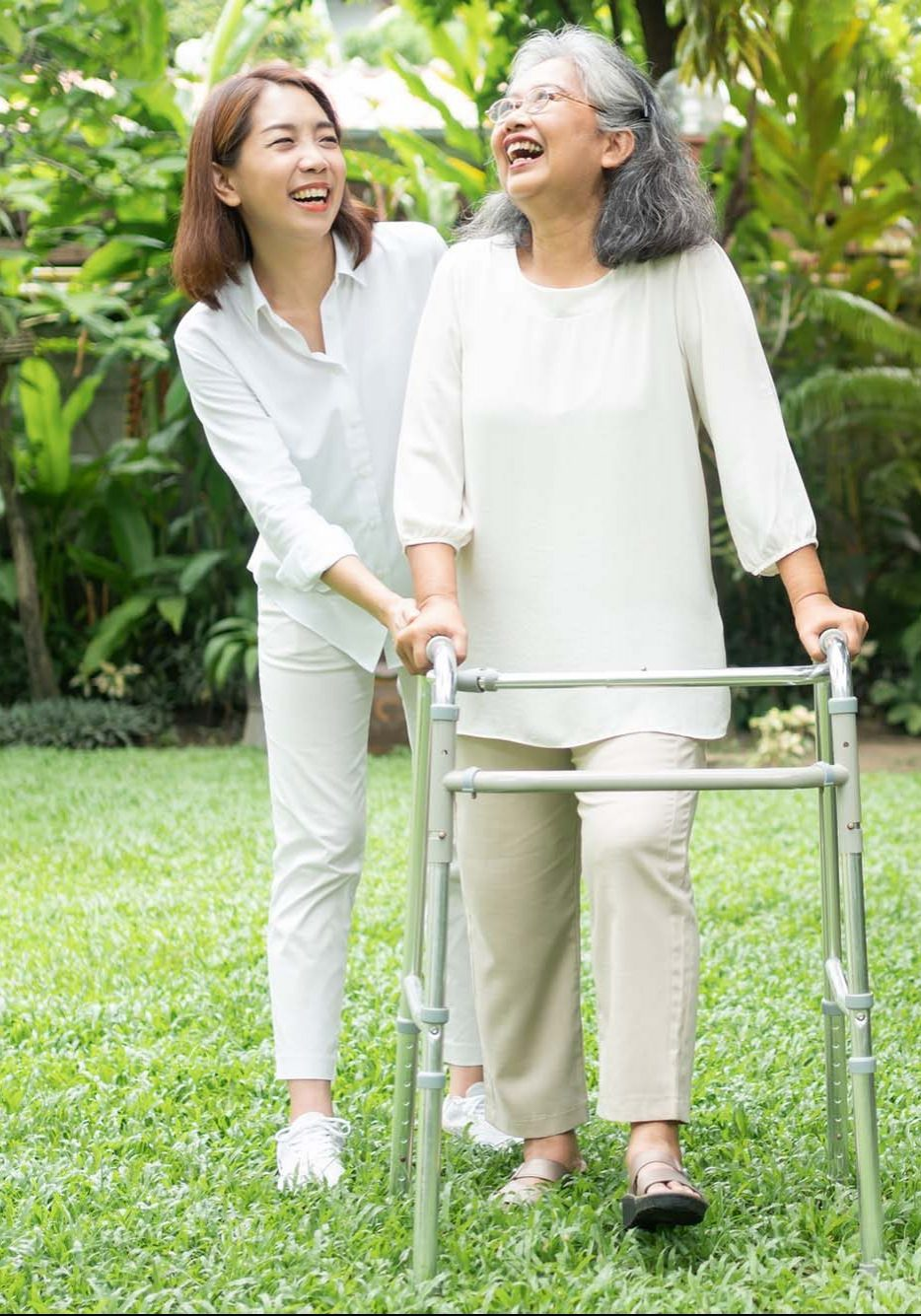 Smiling elderly woman and carer