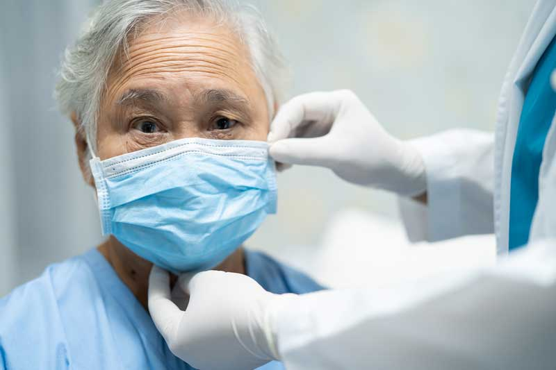 Old Man Wearing Mask To Protect Him From Covid-19